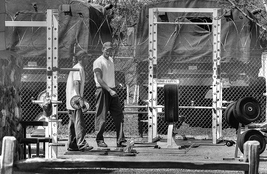 Two inmates interact amid a recreation area at the Colorado Correctional Center in Golden, Colo. The facility, also known as Camp George West, opened in 1969 and houses about 150 inmates, materials from the Colorado Department of Corrections state.