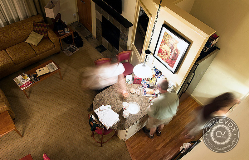 People bustle about a kitchenette at a condo in Vail, Colo.