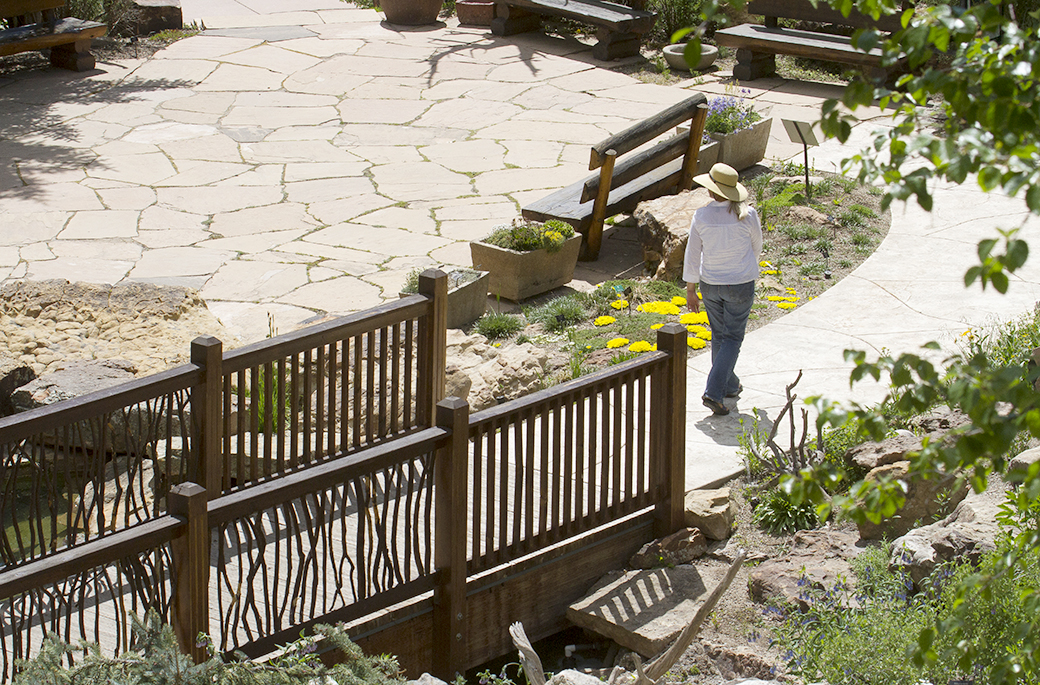 A woman follows a winding path at the Betty Ford Alpine Gardens in Vail, Colo. The site houses the world's highest botanical gardens at 8,200 feet.