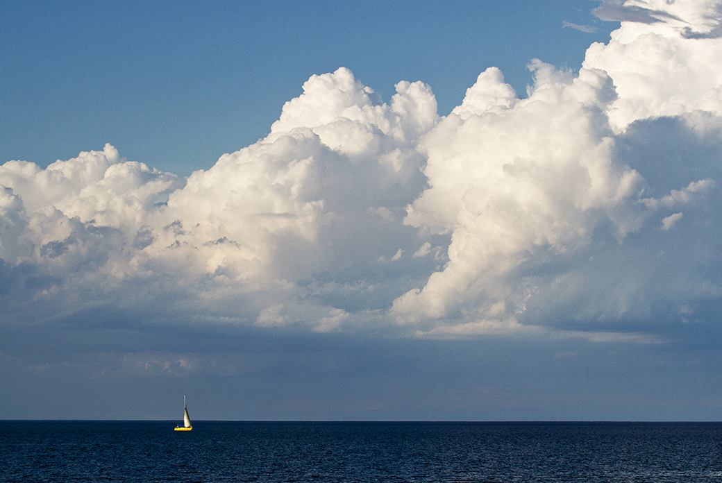 A sailboat floats in the waters north of Chicago's Oak Street Beach on Lake Michigan in late July, 2013.