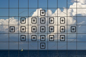 The focus grid on a Canon 7D doesn't allow focus on the sailboat without manual recomposition.