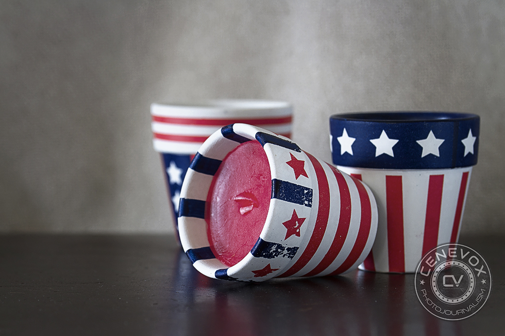Three Americana-themed votives lay on a wooden surface on July 4, 2013.