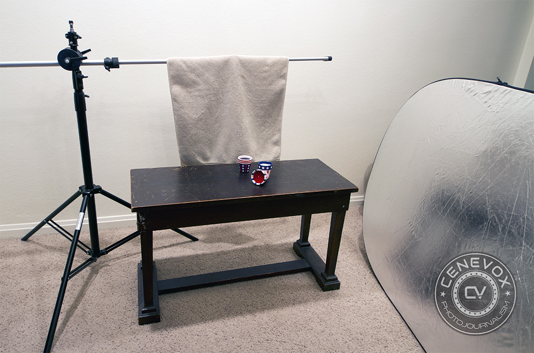 A light stand with boom arm, bath towel, and silver reflector set the stage for a simple Americana-inspired still life.