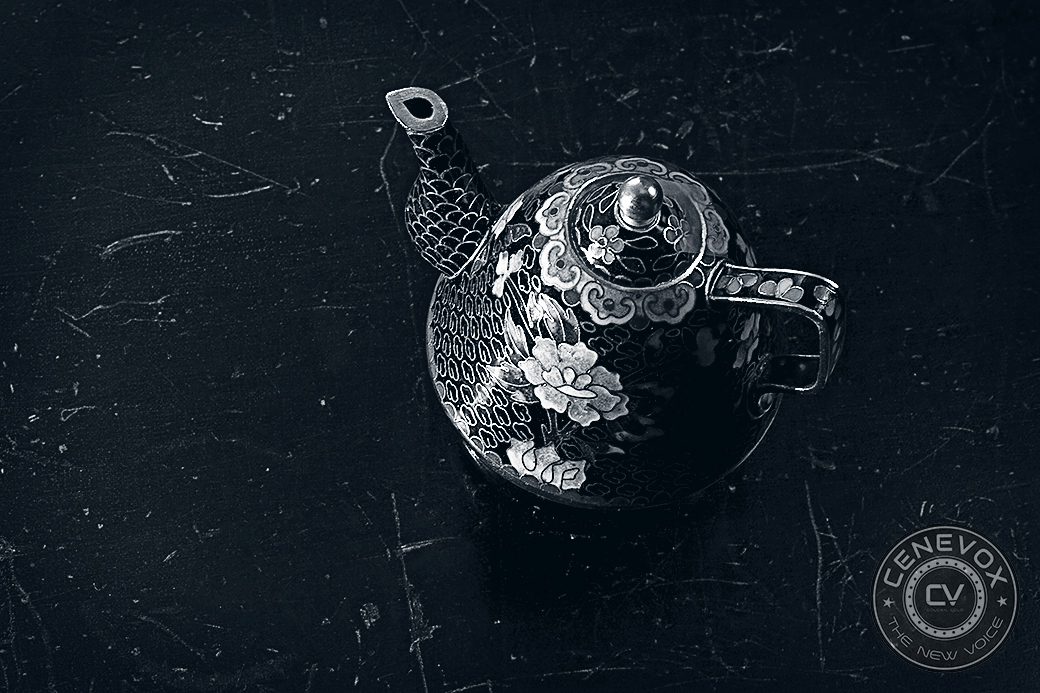 The same teapot, now lit from the front and devoid of the dramatic shadow, lacks visual depth and appeal.