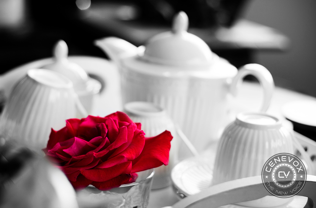 A plucked red rose lies among several pieces of a white tea set at a home in Golden, Colo.