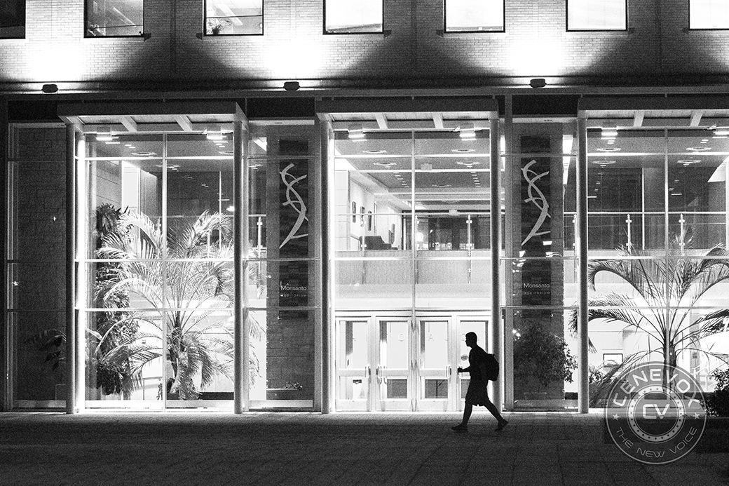 A man walks in front of the University of Missouri-Columbia's Christopher S. Bond Life Sciences Center Sept. 25, 2013.