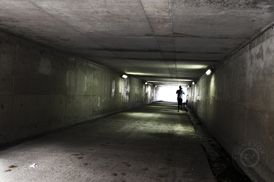 A woman runs through an underpass in Columbia, Mo. on Nov. 15, 2013.
