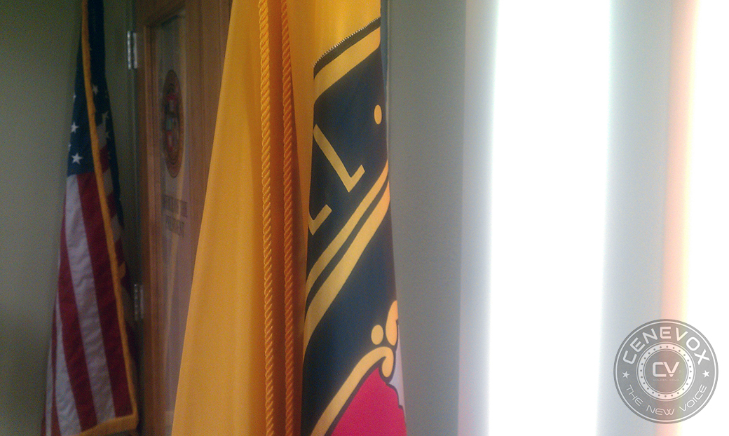 Flags for the University of Missouri and the United States flank the double doors leading to UM System President Tim Wolfe's office in University Hall.