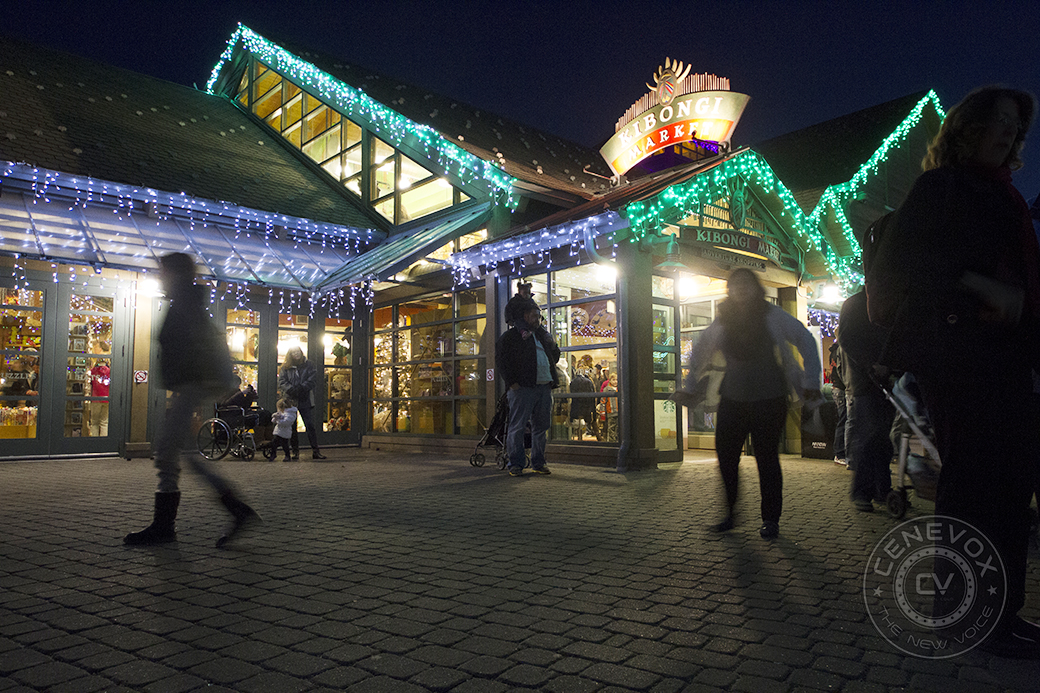 People mill around the entrance to Kibongi Market, the Denver Zoo's gift shop, adjacent the main zoo entrance.