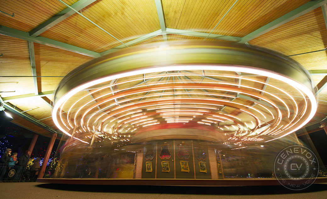 Children and their parents enjoy the Denver Zoo's carousel, constructed by Carousel Works. The attraction features more than 45 hand-carved animals and two chariots.