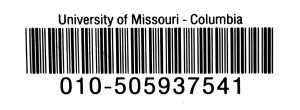 The barcode for CIE 2002 rests on the inside back cover of the book at the Frank Lee Martin Journalism Library at the University of Missouri.