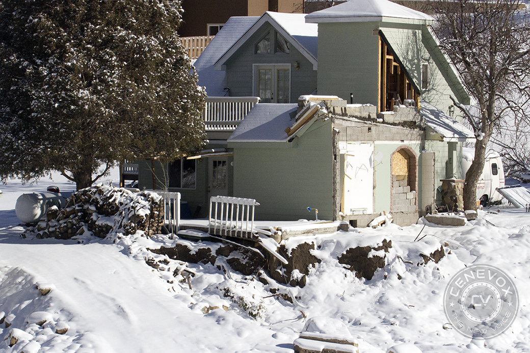 Flood light photography definition : Snow clings to a damaged home in lyons colo one of