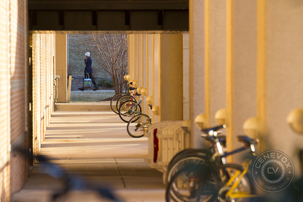 A woman talks on a cell phone while walking past the University of Missouri's Mizzou Recreation Center.