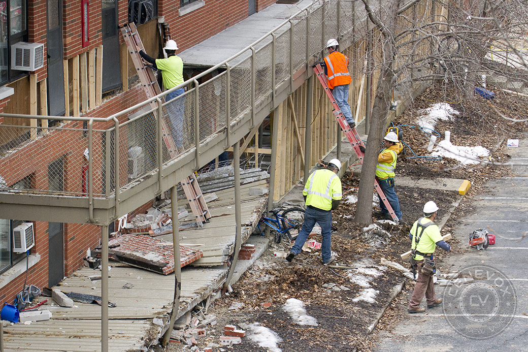 MU Campus Facilities employees bolster the external structure of Building 707 at University Village Saturday afternoon.
