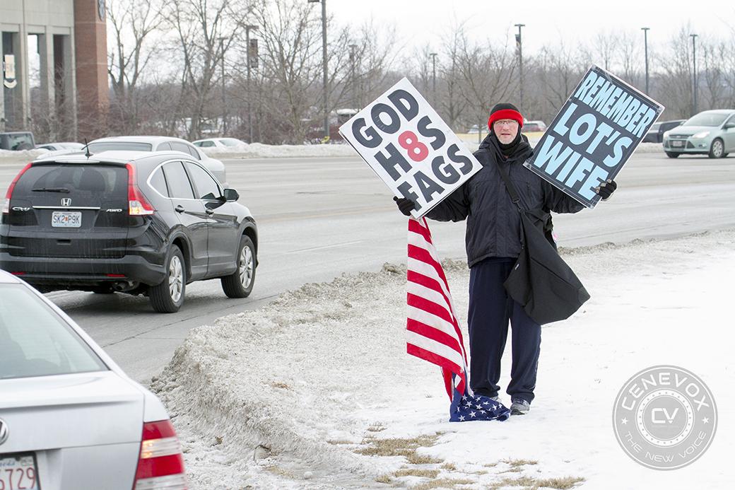 A Westboro Baptist Church member protests at the corner of Stadium Boulevard and South Providence Road in Columbia, Mo. The group visited the University of Missouri on Feb. 15, 2014, in response to Mizzou alumnus Michael Sam's Feb. 10 public announcement that he is gay.
