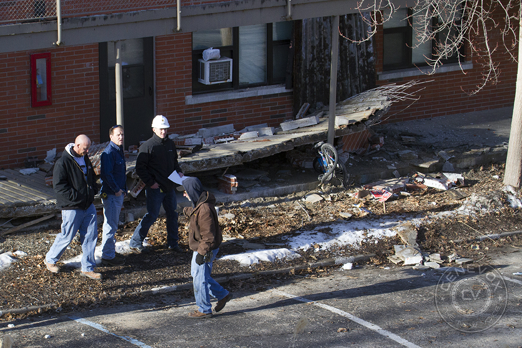 University of Missouri personnel, including Gary L. Ward, associate vice chancellor for facilities, survey the damage at Building 707 in University Village, where a walkway collapsed early Saturday morning.