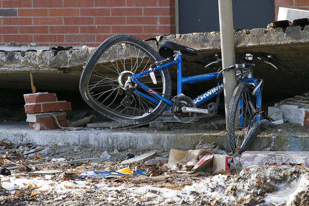 A mangled blue bike lies under a collapsed walkway at Building 707 in the University Village student housing complex. A walkway partially collapsed early Saturday morning and all 18 residents were safely evacuated, MU Spokesman Christian Basi said.