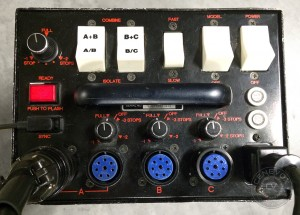 Several switches and knobs control lighting ratios and power outputs for a one-light setup on a Speedotron 1205CX Power Pack.