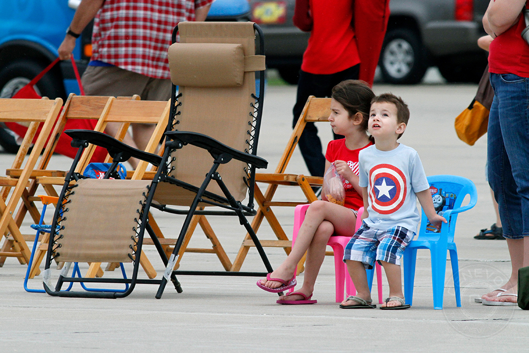 Landon, 2, and Cheyenne, 8, Kingcade, along with mother, Valerie, watch the 2014 Salute to Veterans Air Show on Saturday, May 24, 2014, at Columbia Regional Airport.