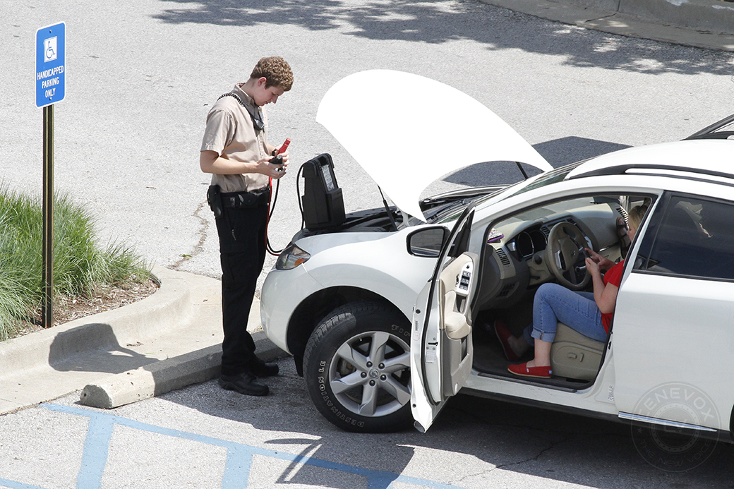 A University Hospital security officer jumpstarts a woman's car in a parking lot adjacent the Ellis Fischel Cancer Center in Columbia, Mo.