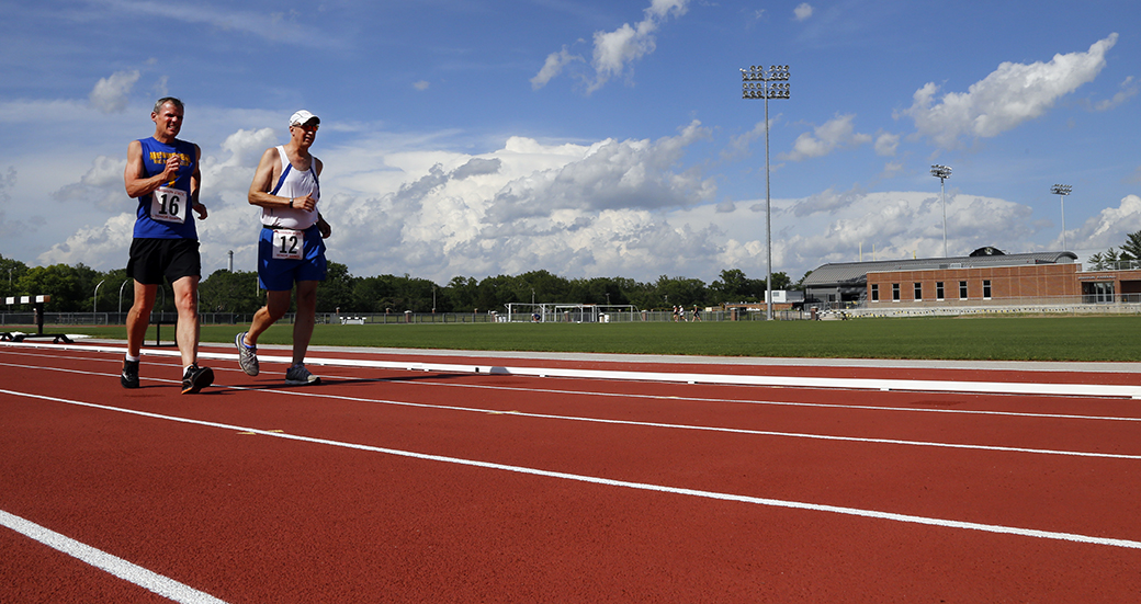 Jim Scott, of Springfield, Ill., left, and Gene Hall, of St. Louis, warm up prior to the 1500-meter Race Walk during the 2014 Missouri State Senior Games at Walton Stadium on June 20, 2014.