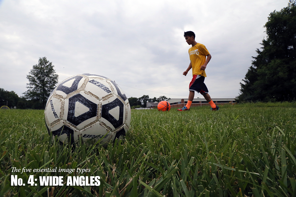 Hla Yu, 18, of Myanmar, retrieves a stray ball during a soccer camp behind Broadway Christian Church.