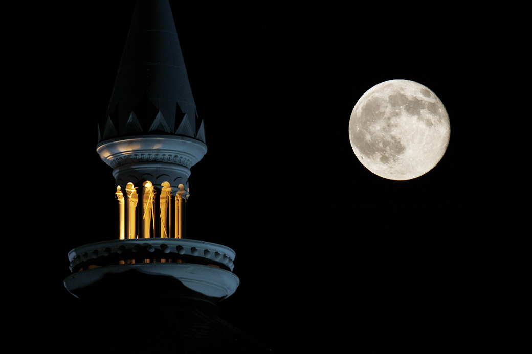 "COMPOSITE: A perigee, or ""super moon,"" rises above Columbia, Mo., on July 12, 2014, in this composite image."