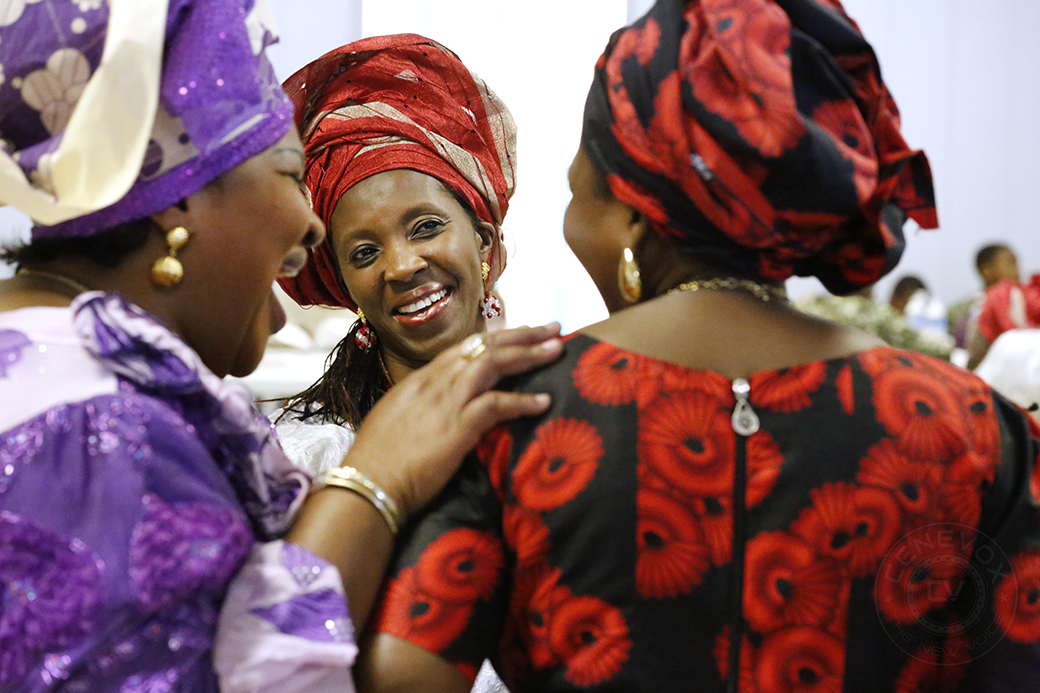 From left, Cyrilla Ayoola, Moyo Ibitoye and Adenike Bashorun enjoy each other's company during a celebration of the Egbe Omo Oduduwa mid-Missouri chapter's 15th anniversary at American Legion Post 202 on Aug. 2, 2014.