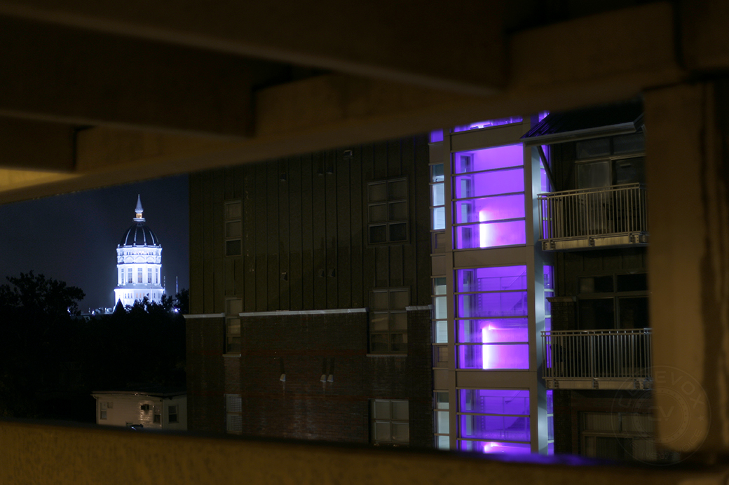 A lighted stairwell at The Lofts at 308 Ninth shines while rain falls over Columbia and the University of Missouri's Jesse Hall on Sept. 1, 2014.