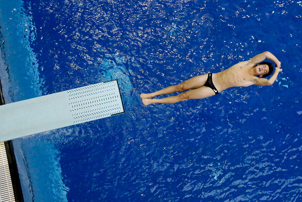 Elliot Cecil works on his backflip technique at the Mizzou Aquatic Center on Sept. 17, 2014. The diving well is kept at a temperature between 84 and 86 degrees.