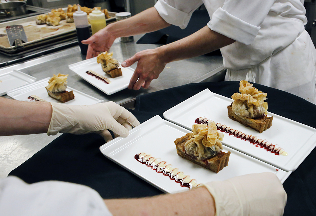 Pliska's staff puts the finishing touches on a series of warm plum tarts baked in a linzer crust. A made-from-scratch lemon champagne sabayon sauce accompanied the tarts.