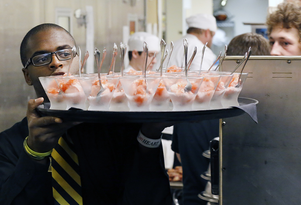 One of Pliska's staffers carries out the intermezzo, a fruit sorbet, during a Southeastern Conference University gala on Oct. 14, 2014.