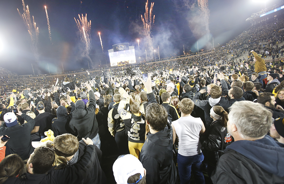 Fans rushed the field after Missouri beat Arkansas 21-14 at Memorial Stadium on Nov. 28, 2014. Metadata: f/4.5; 1/85; ISO 1250; 16mm focal length
