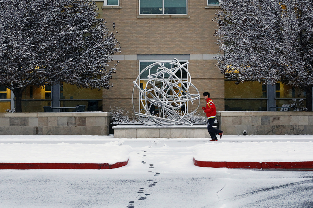 "A man jogs past Douglas Kornfeld's 2008 ""Gordian Knot"" sculpture at the Colorado School of Mines campus on Dec. 22, 2014. The accompanying plaque reads, ""In 333 BC Alexander the Great attempted to untie the Gordian Knot. Finding no end to the knot, or a way to unbind it, Alexander sliced it in half with his sword. ""Cutting through the Gordian Knot"" is often used as a metaphor for a complex or intractable problem solved by a single or bold stroke."""