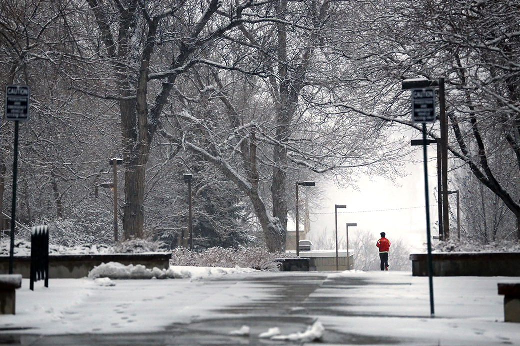 A man jogs through the Colorado School of Mines campus on Dec. 22, 2014.