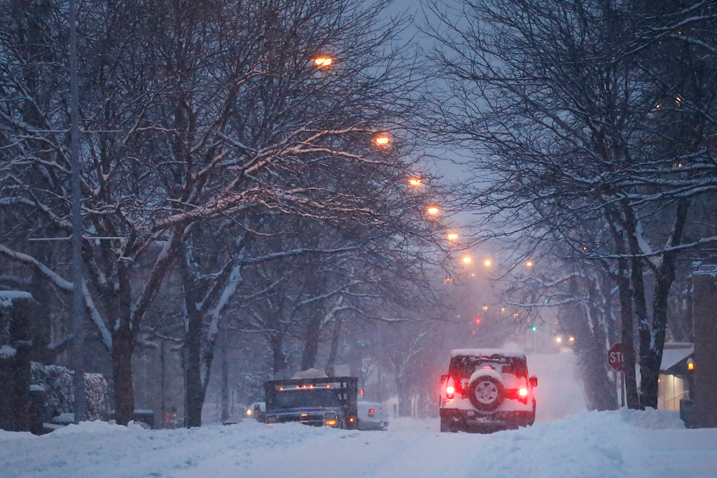 The driver of a jeep brakes on snowy roads for a stop sign on Ninth Street early Monday. About 6 inches of snow fell between 8 p.m. Sunday and 4 a.m. Monday, according to the Columbia Public Works Department.