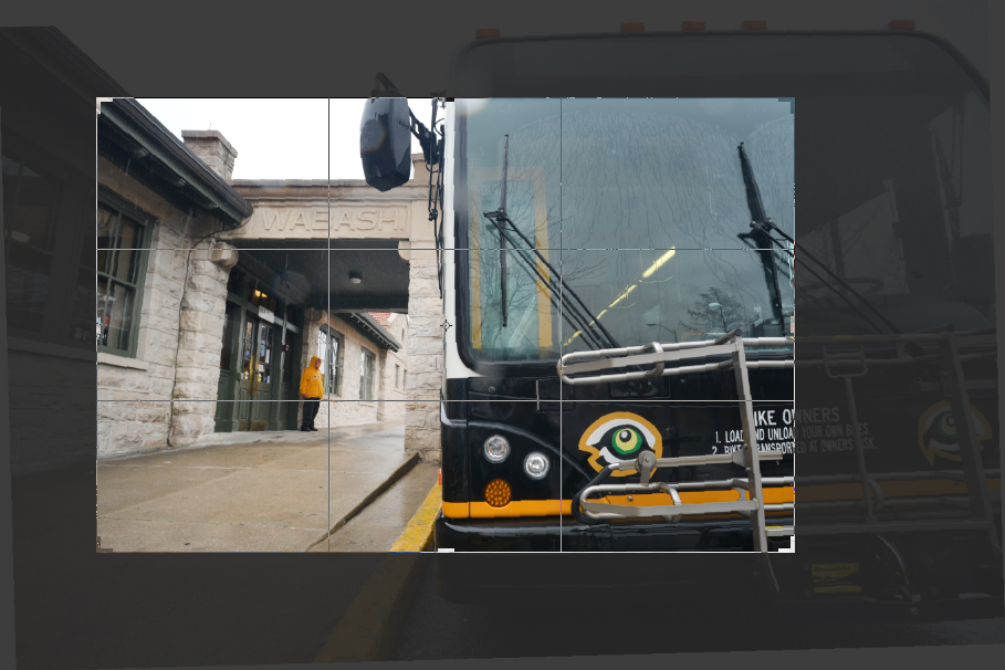 Steven is now a more prominent part of the composition, is in an intersecting third of the frame, and the color similarities between the bus and his jacket are highlighted.