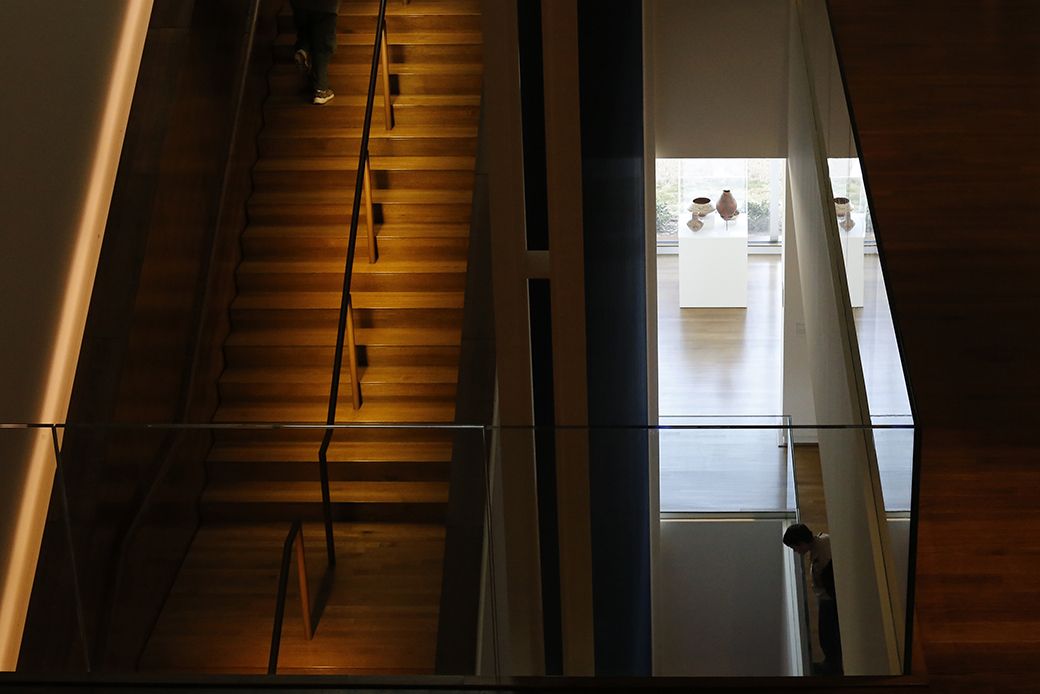 A boyscout peers over the second-floor overlook at the University of Oklahoma's Fred Jones Jr. Museum of Art.