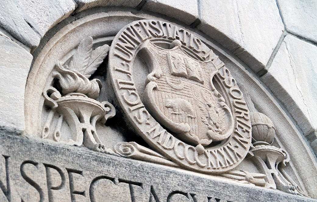 "John S. Ankeney designed the University of Missouri seal and its board of curators adopted it on March 31, 1903. The seal includes the university's motto, ""Salus Populi,"" along with a crescent, grizzly bear, and the U.S. arms."