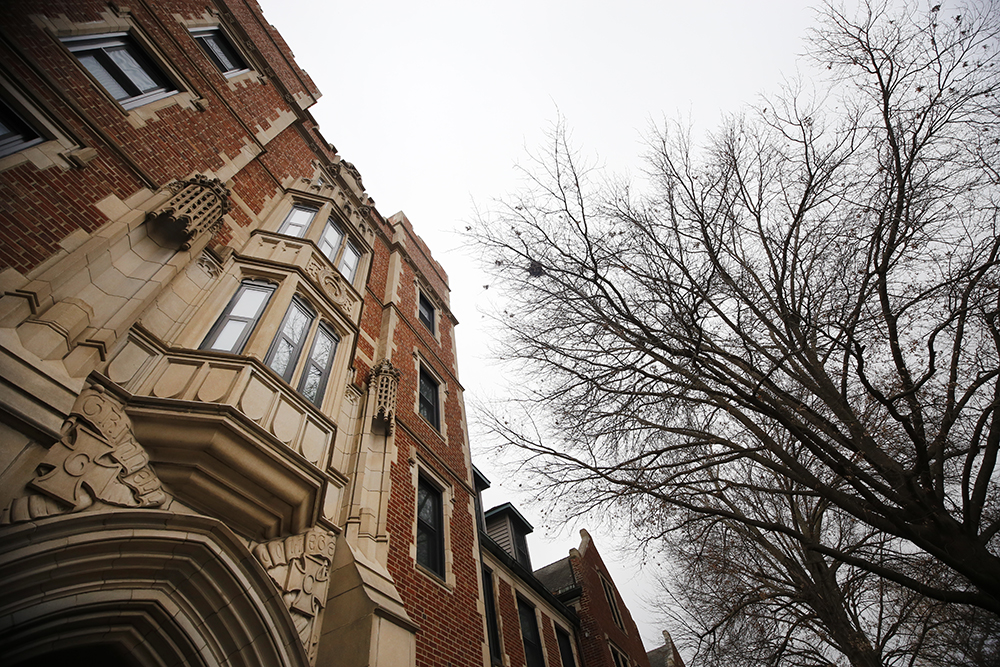 The gothic walls of Gates Hall rise adjacent barren trees at Grinnell College on Nov. 25, 2015. The hall acquired its name from the college's second president, George Augustus Gates, who headed the institution from 1887 to 1900. Metadata: f/10; 1/100; ISO 649; 16mm focal length